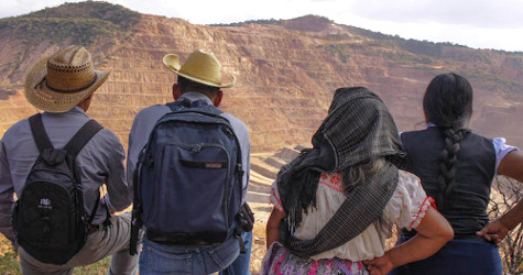 Community members look on Los Filos open pit mine in Guerrero, Mexico.