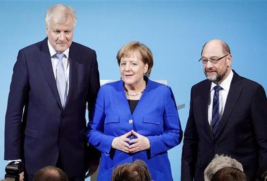 German SPD votes in favor of 'grand coalition' with Merkel